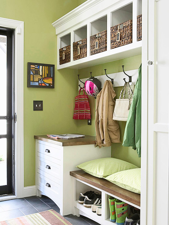 Beautiful clean and tidy entry way with wicker storage boxes and a bench is also a shoe rack